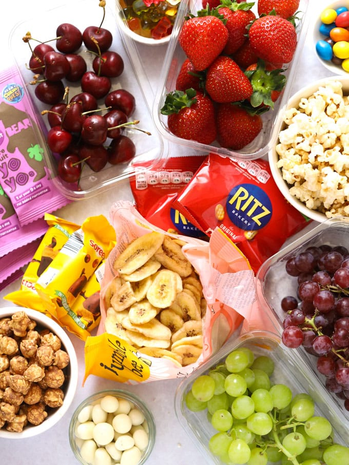 Banana chips, strawberries, cherries, grapes, popcorn and treats