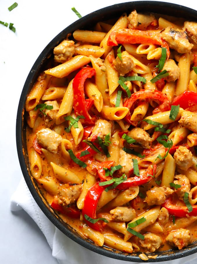 Easy sausage pasta recipe made in one pot with peppers, tomatoes and garlic