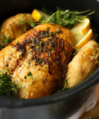 Whole chicken roasted in a slow cooker