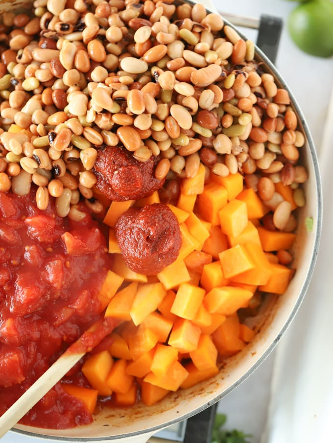 Making vegan chilli with butternut squash and beans