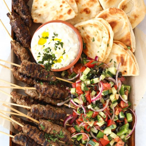 Lamb kofta kebabs recipe with flatbreads and Greek salad and tzatziki