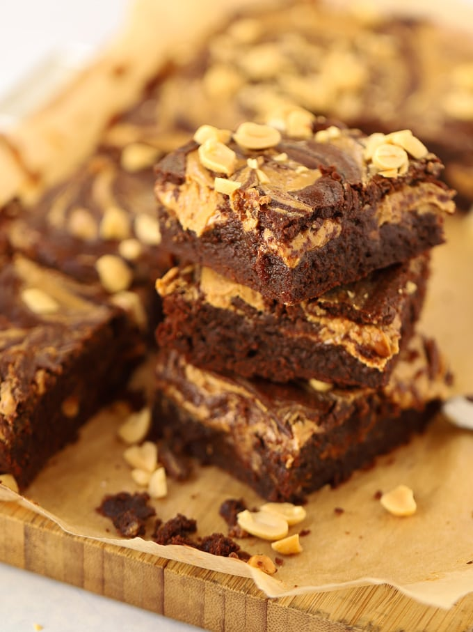 Piled brownie squares topped with peanuts