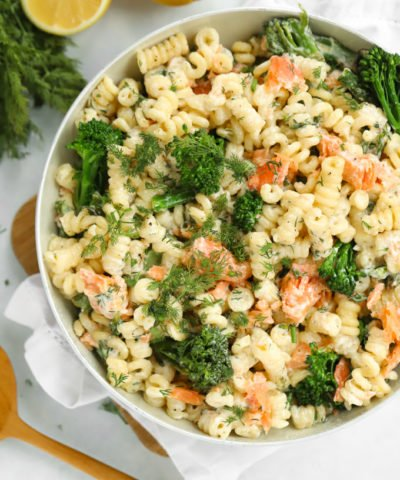 Smoked salmon pasta in a large pan sprinkled with dill