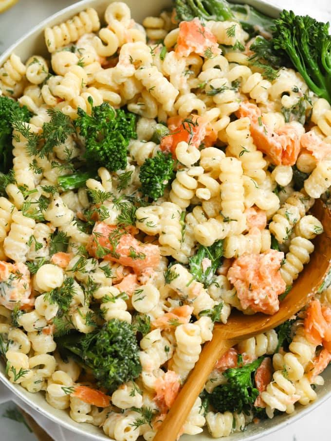 Pan of pasta with smoked salmon, tenderstem broccoli and lemon