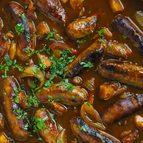 Sausage casserole recipe slow cooked with cider and bacon