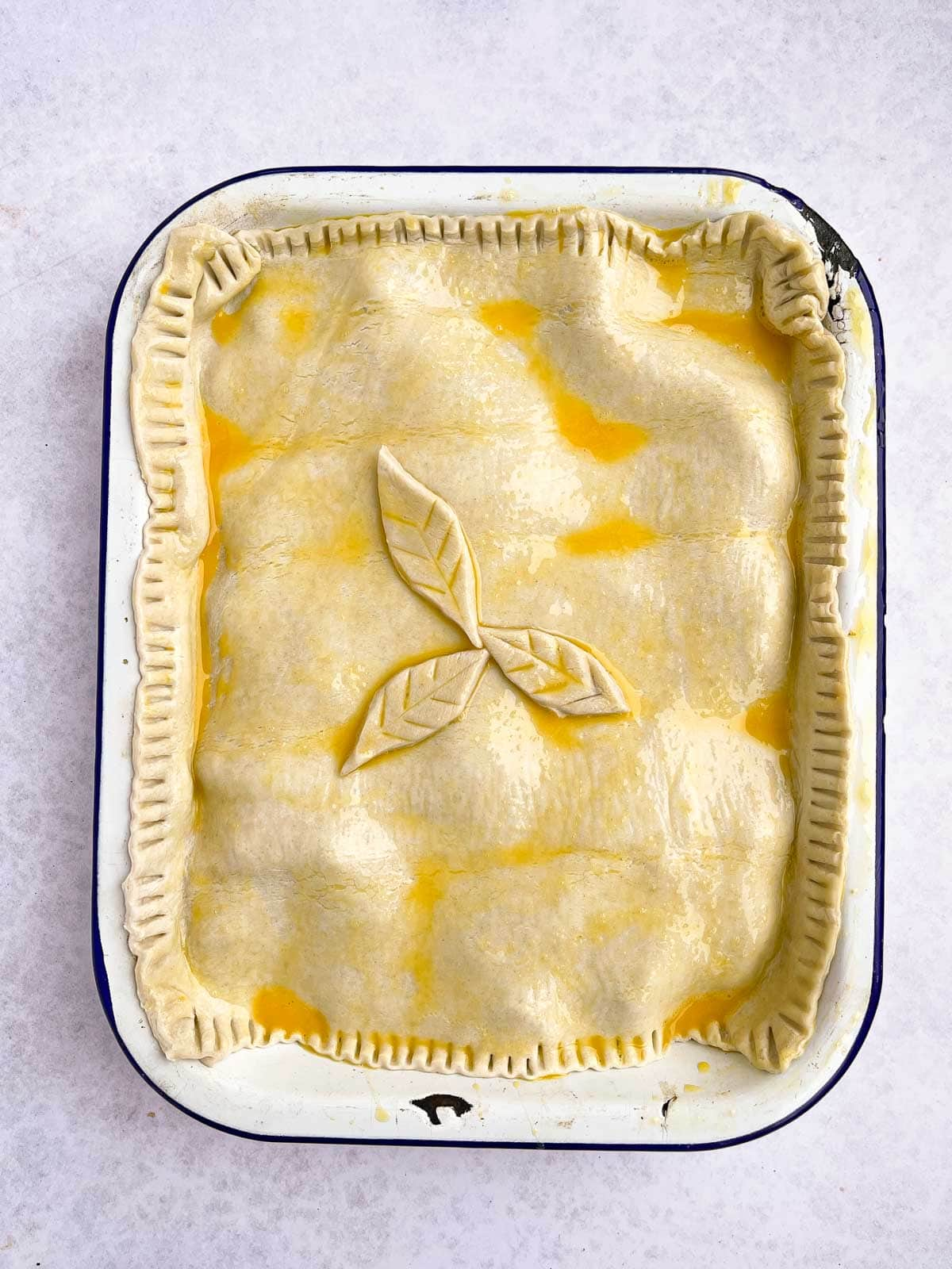Uncooked beef pie ready for the oven